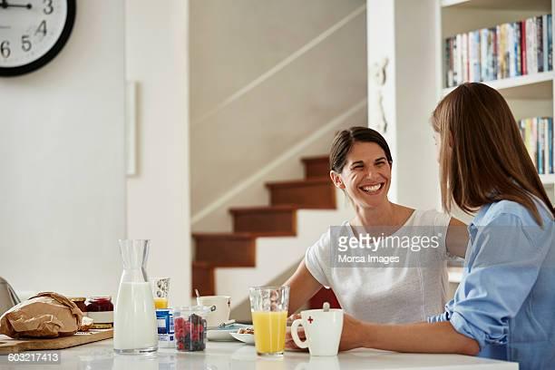 Happy lesbian couple having breakfast