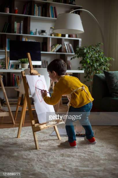 happy little baby artist drawing with colorful paints at home - easel stock pictures, royalty-free photos & images