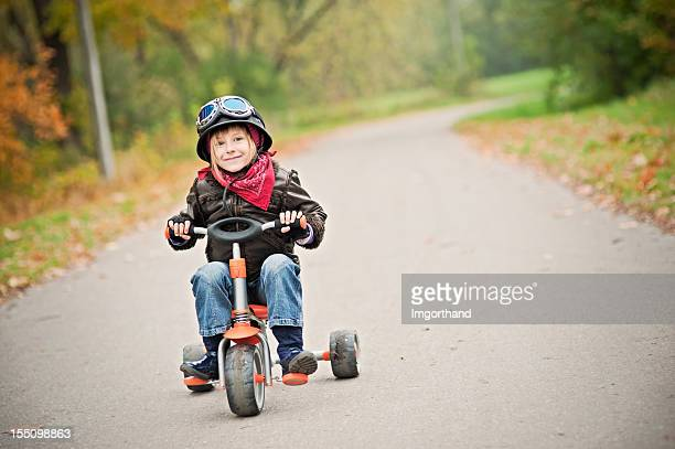 happy little biker - tricycle stock pictures, royalty-free photos & images