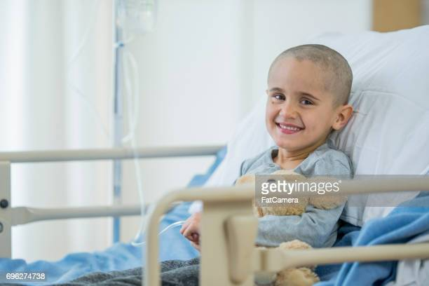 happy little boy battling with cancer - cancer stock photos and pictures