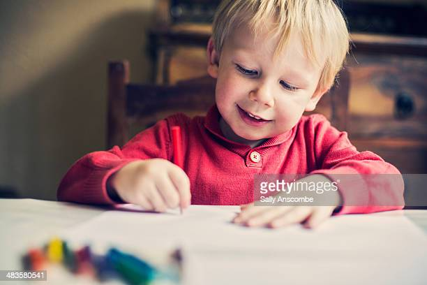 happy little boy drawing a picture - colouring stock photos and pictures