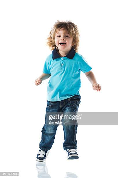 Happy little boy  having fun and jumping.