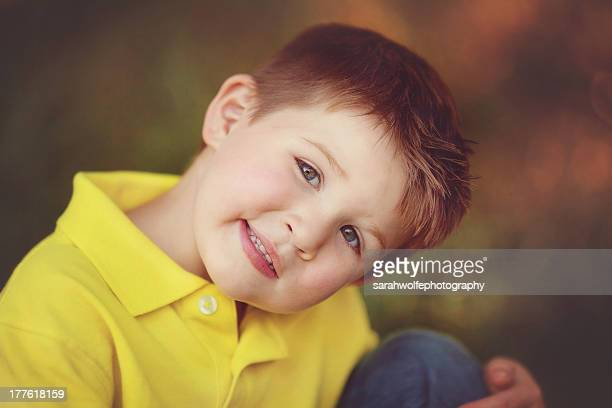 happy little boy in a yellow shirt