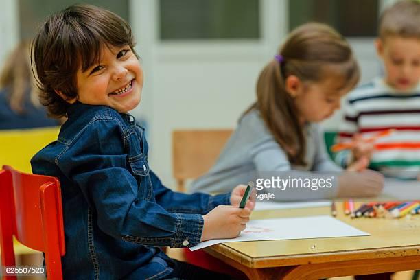 Happy Little Boy In Kindergarten