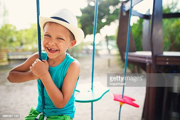 Happy little boy laughing at the playground