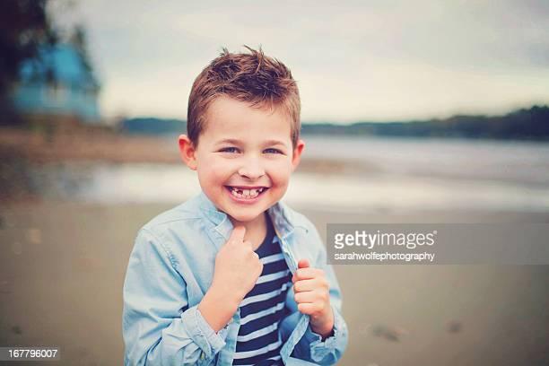happy little boy on a beach