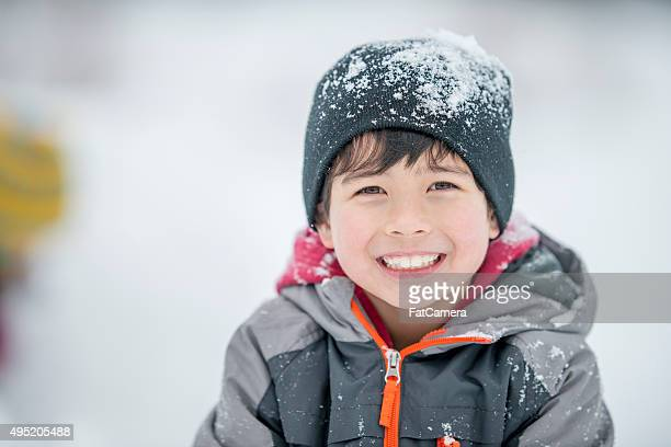 Happy Little Boy Playing in the Snow