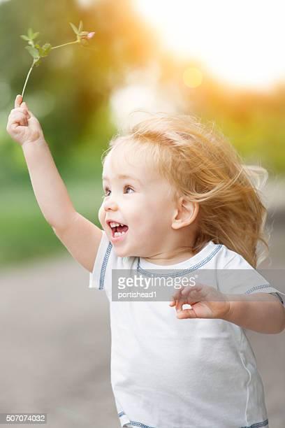 Happy little boy running and having fun