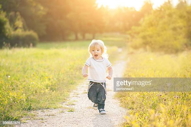 Happy little boy running and having fun