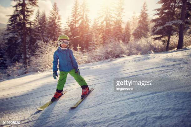 Happy little boy skiing on a beautiful winter day
