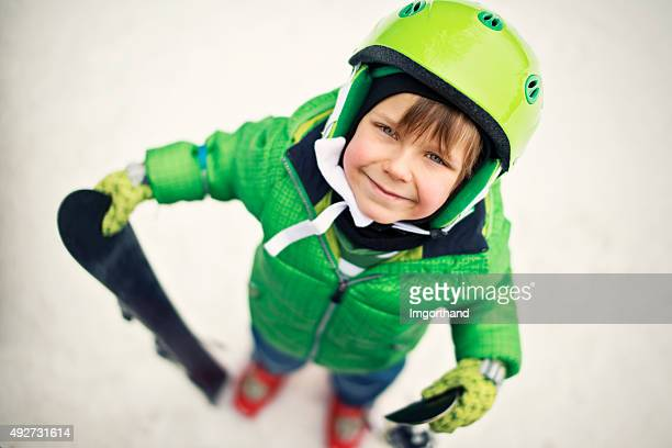 Happy little boy skiing