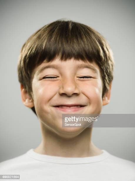 happy little boy smiling - eyes closed stock pictures, royalty-free photos & images