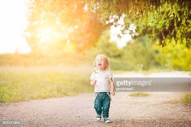 Happy little boy walking and having fun