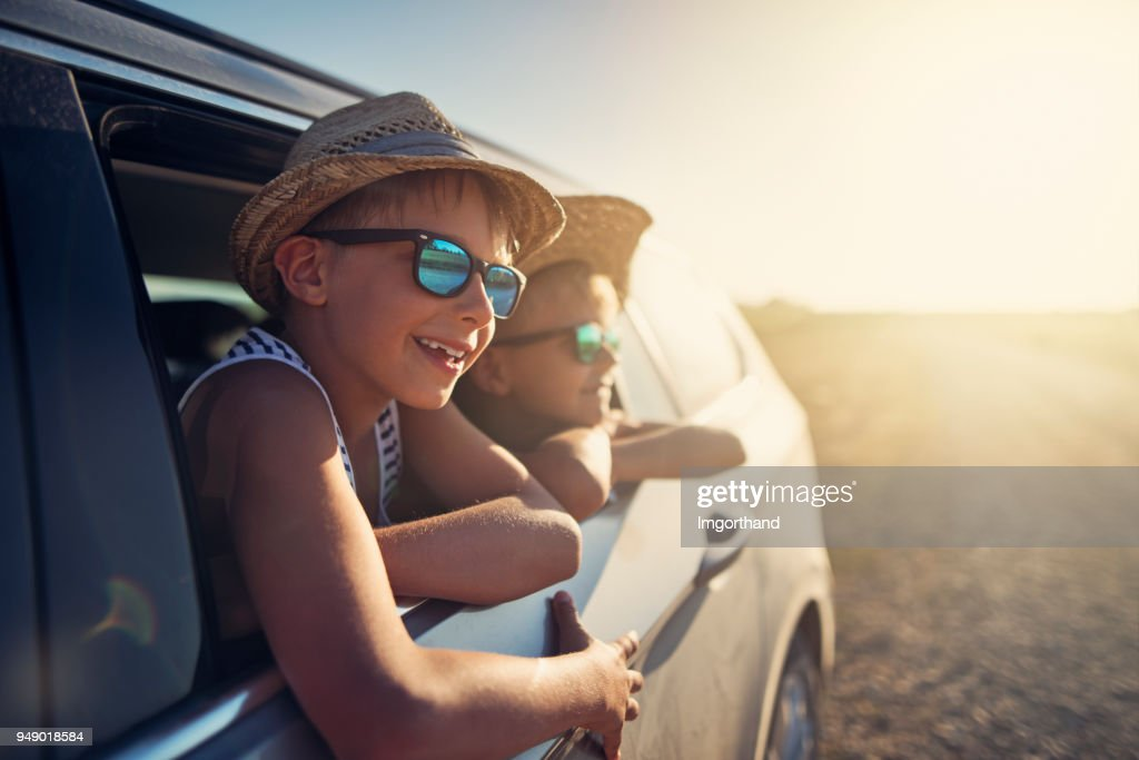Happy little boys enjoying road trip : Stock Photo