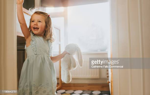 happy little girl and toy - wave stock pictures, royalty-free photos & images