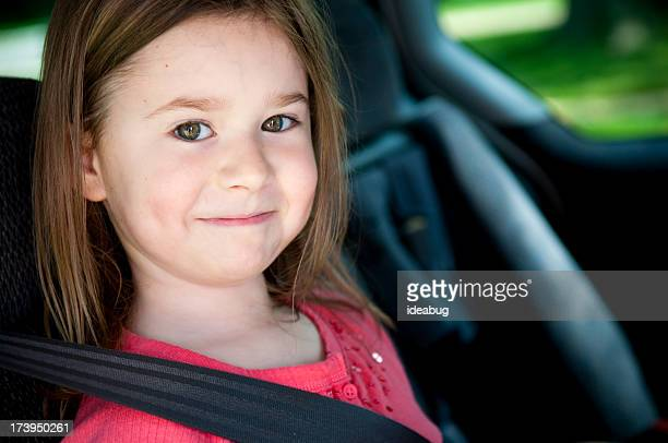 Happy Little Girl Buckled Up with Seatbelt