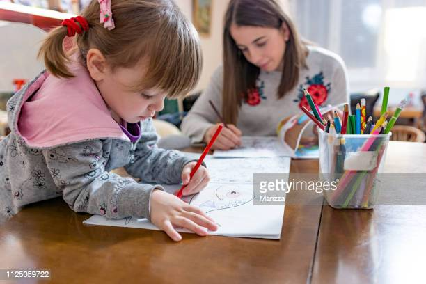 happy little girl drawing at home - niece stock pictures, royalty-free photos & images