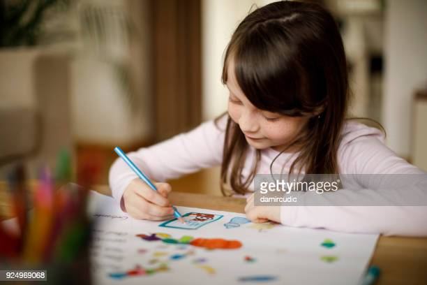 happy little girl drawing at home - colouring stock pictures, royalty-free photos & images
