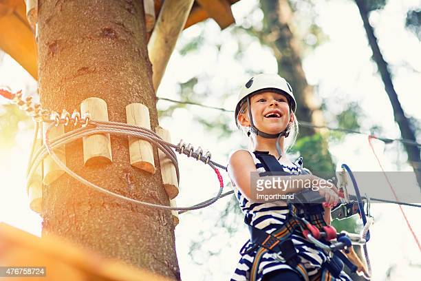 Happy little girl during canopy tour.