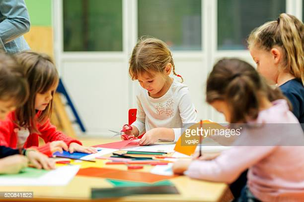 Happy Little Girl Having Creative Activity in kindergarten.