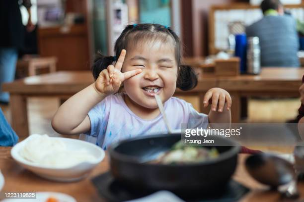 happy little girl having meal - south korea stock pictures, royalty-free photos & images
