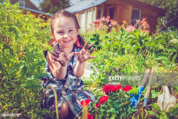 happy little girl in garden - little russian girls stock photos and pictures