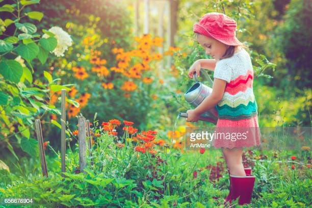 Happy little girl in garden