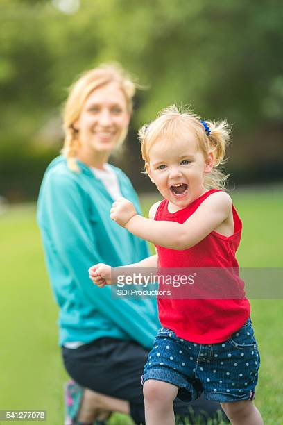 Happy little girl in patriotic colors running in field