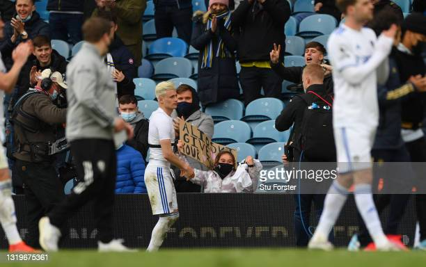Happy little girl in the crowd smiles after Ezgjan Alioski of Leeds gives her his playing shirt after the Premier League match between Leeds United...