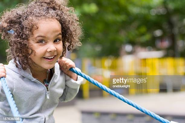 Happy Little Girl Out in the Playground