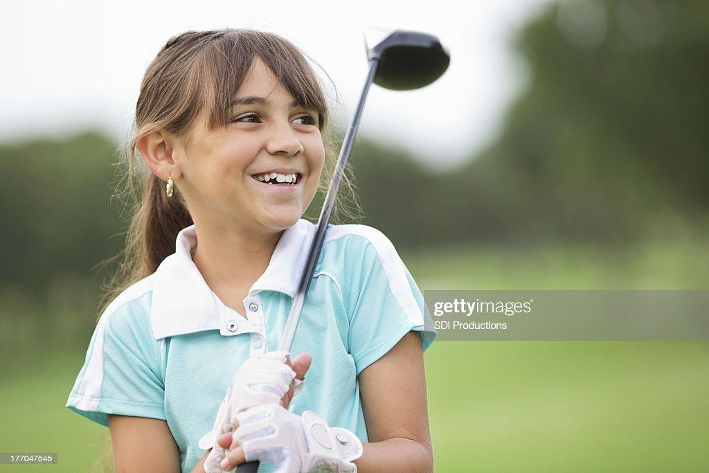 Happy little girl playing golf at country club : Stock Photo