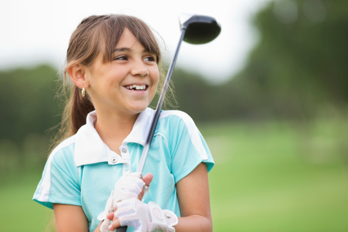 Happy little girl playing golf at country club 177047545