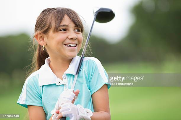 happy little girl playing golf at country club - golf stock pictures, royalty-free photos & images