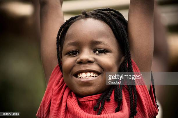 happy little girl playing on playground - uganda stock pictures, royalty-free photos & images