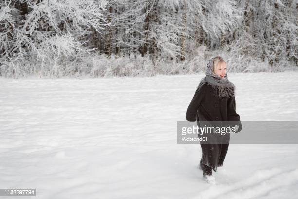 happy little girl running on snow field - snowfield stock pictures, royalty-free photos & images