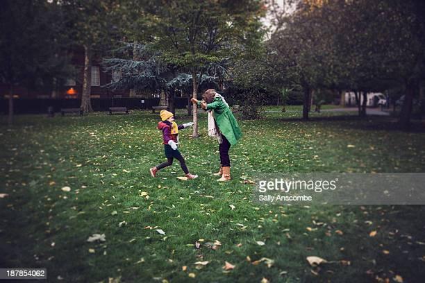 happy little girl running to meet her grandmother - 中距離 ストックフォトと画像