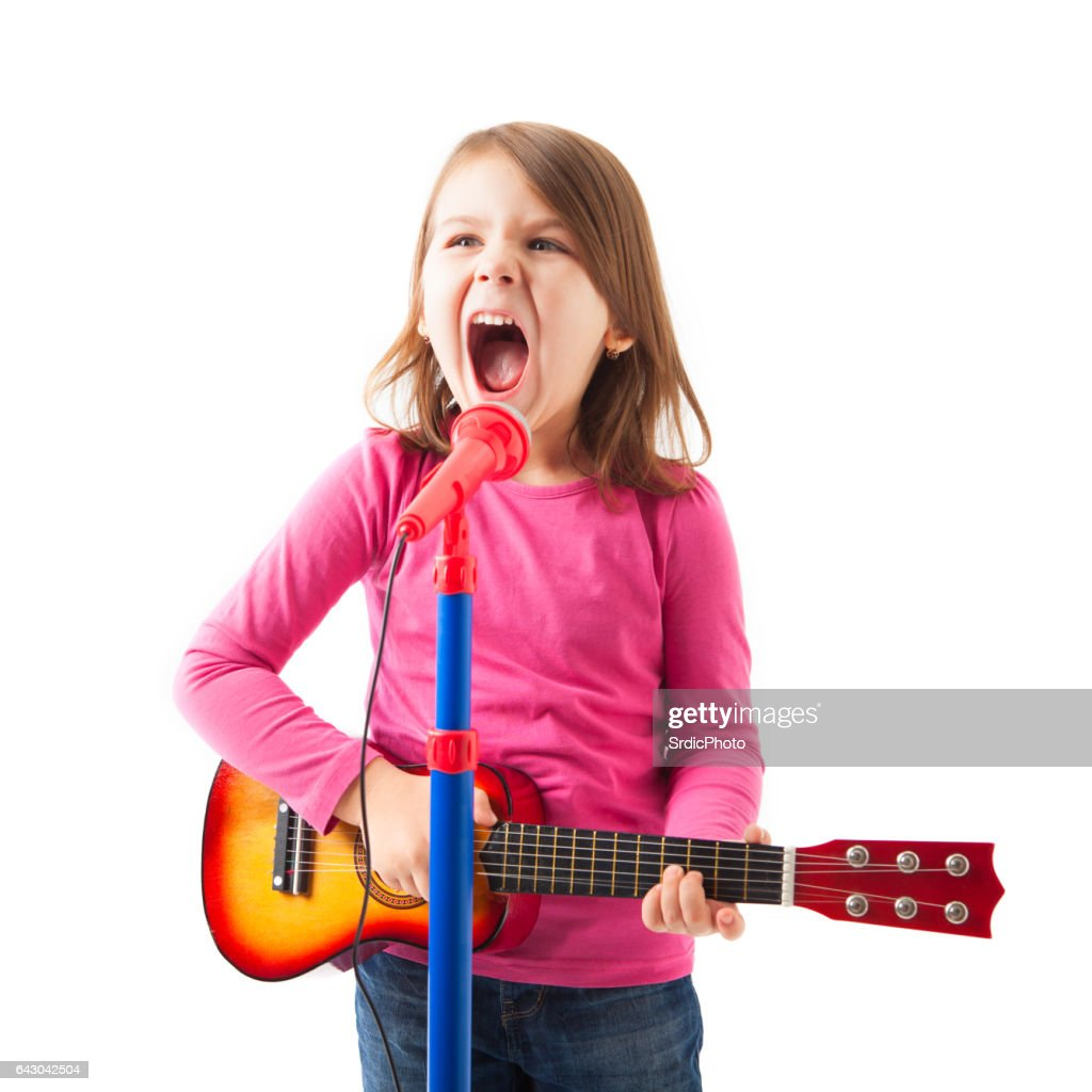 Happy Little Girl Singing Stock Photo - Getty Images