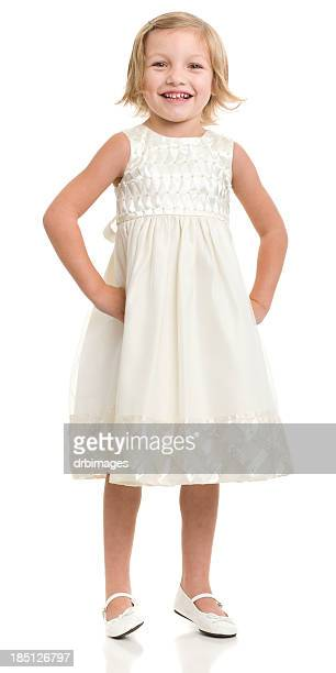 happy little girl standing in dress - cut out dress stock pictures, royalty-free photos & images