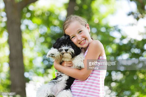 Happy Little Girl with Family Pet Dog