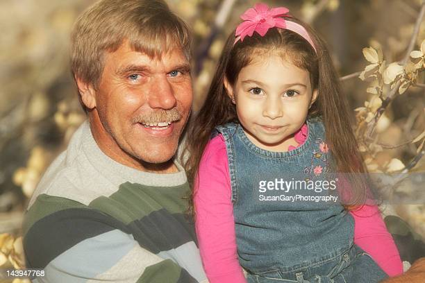 happy little girl with her great uncle - niece stock pictures, royalty-free photos & images