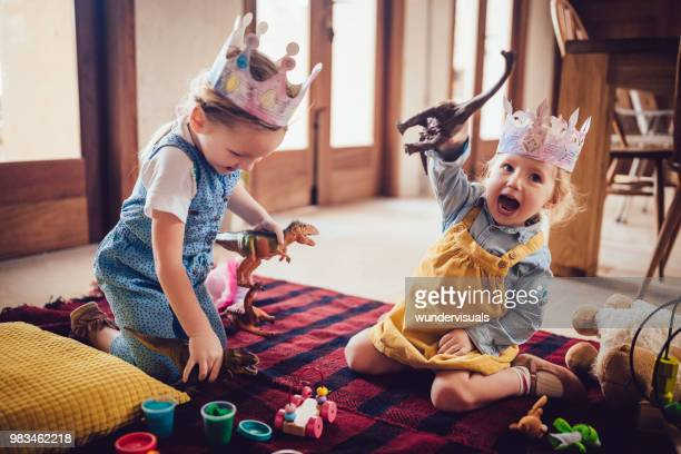 happy little girls having fun playing with toys - leisure games stock pictures, royalty-free photos & images