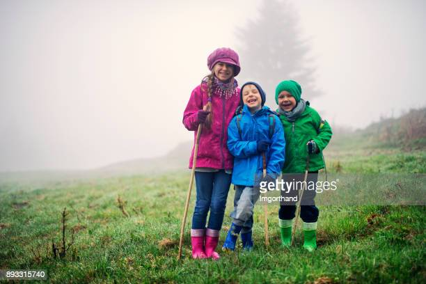 Happy little hikers on a misty spring day