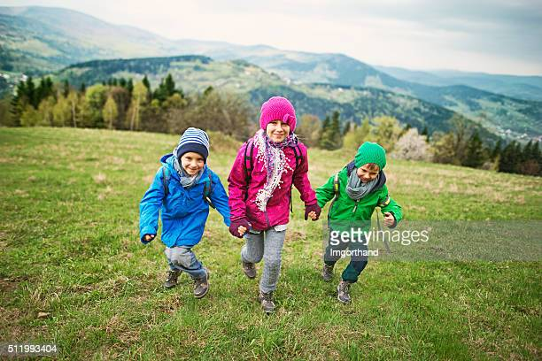 Happy little hikers running in the mountains