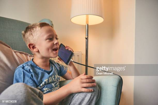 Happy little kid talking on mobile phone
