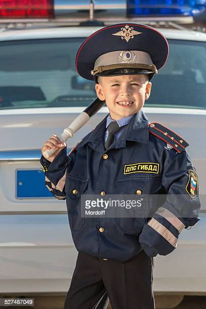 Happy little police officer