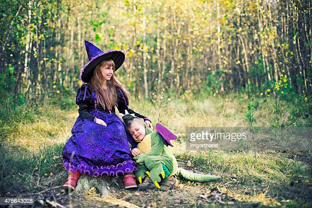 happy little witch and pet her dragon. - monster fictional character stock pictures, royalty-free photos & images