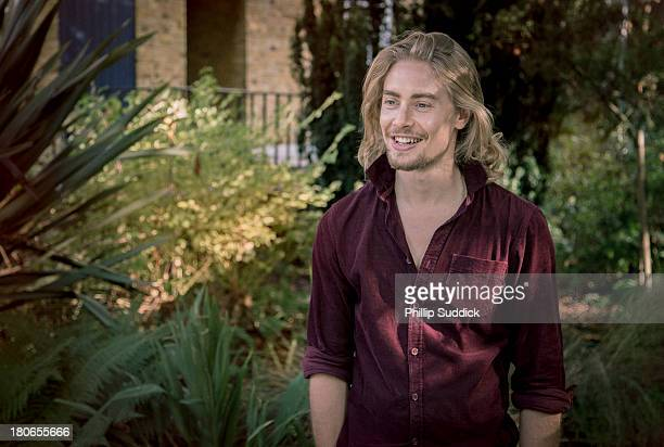 Happy long haired man with goatee in garden