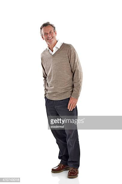 Happy looking mature man standing over white