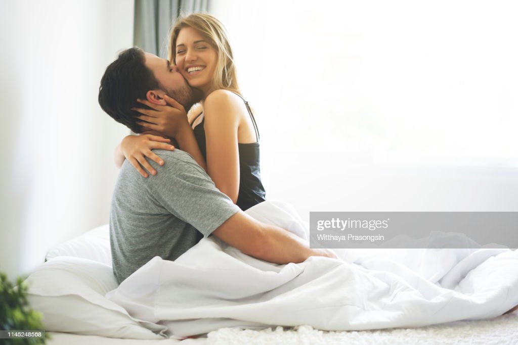 Happy Lover Kissing And Hugging High-Res Stock Photo - Getty Images