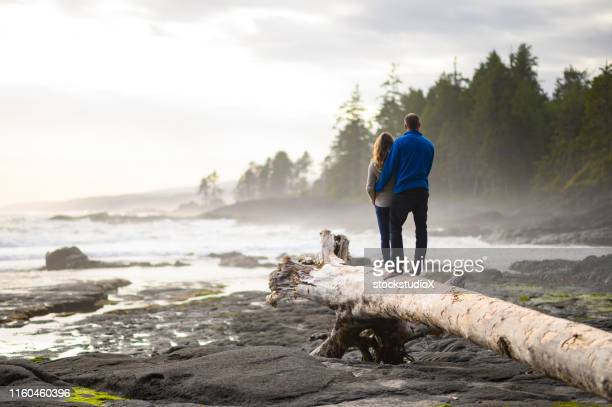 happy loving couple bonding on vacation - mid adult stock pictures, royalty-free photos & images